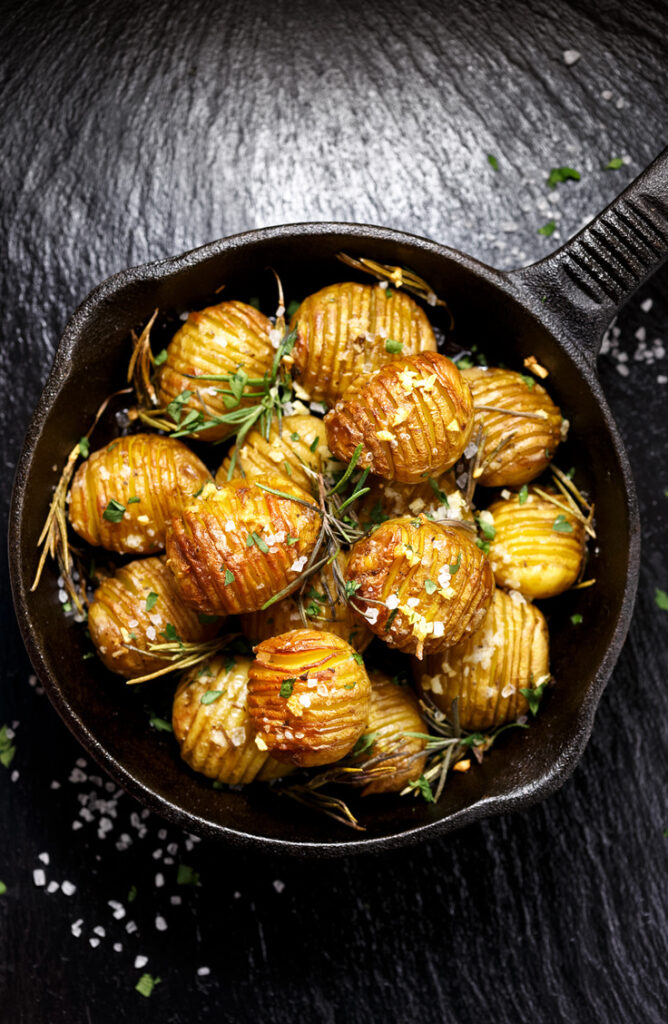 When it comes to side dishes, the potato is king of them all. Not only are these potato side dishes easy, but they are so versatile. This garlic butter hasselback potato recipe is amazing!