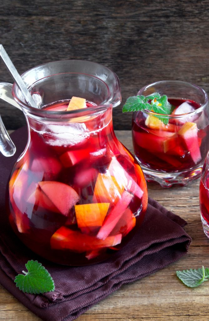 Want your kids to enjoy summer without over-heating? Here is a list of super cool summer drinks for kids that they will love drinking! This sangria mocktail is full of fruit and will be so refreshing!