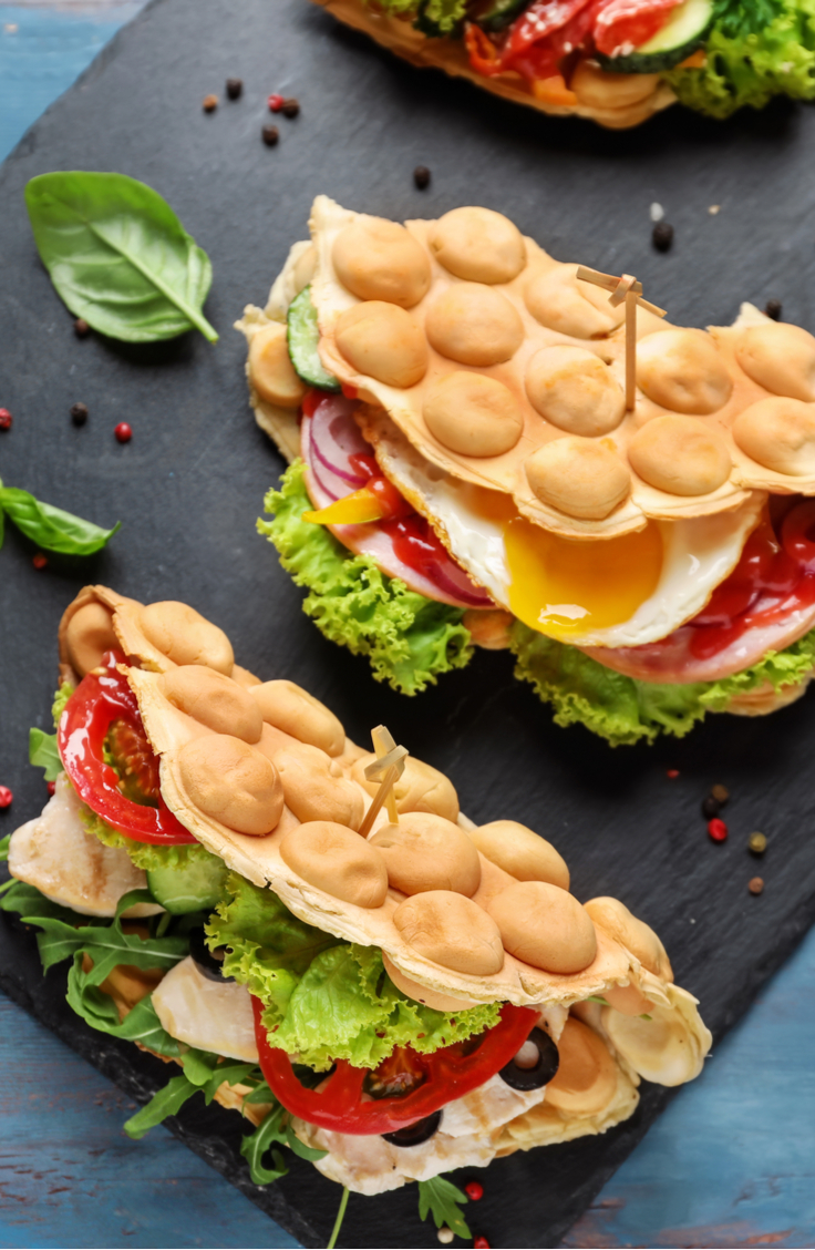 If you haven't seen the hype around bubble waffles, you're not alone. However, if you love breakfast food, it's time you hop on the bubble waffle bandwagon! Bubble waffle sandwiches will change your life!