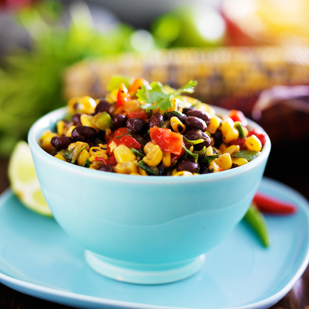 If you're having a group of people over to watch the big football game, then you need to know these football party foods. This fire-roasted corn and bean salsa is incredible!