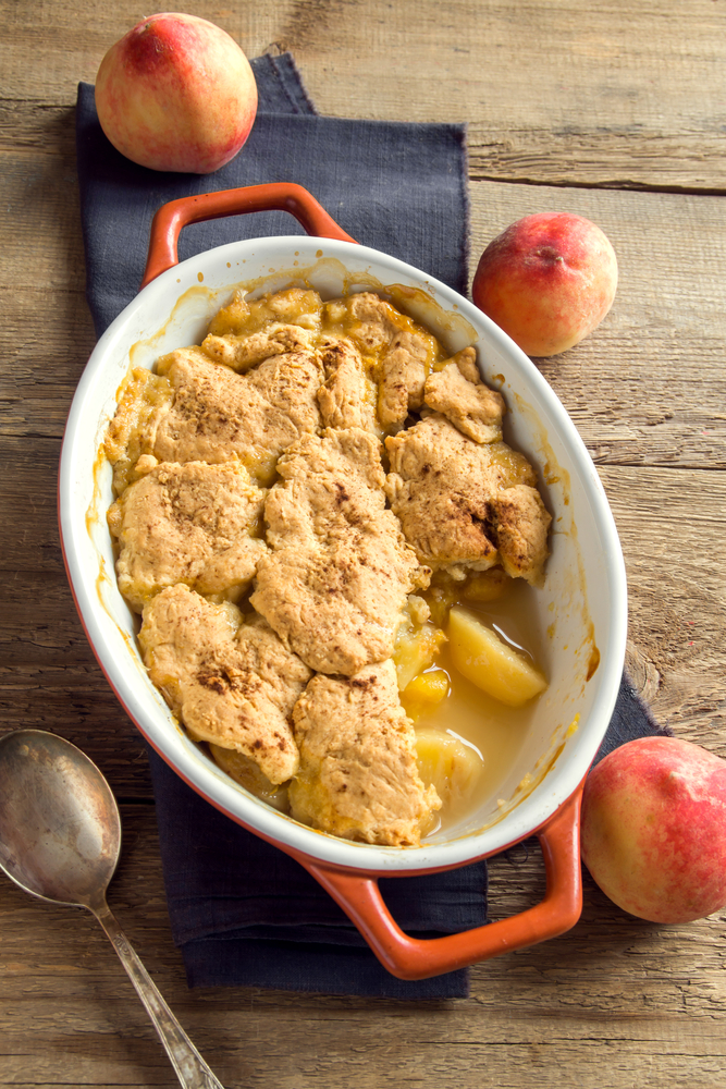 There is nothing quite as good as a dutch oven peach cobbler. This amazing dutch oven peach cobbler recipe is one that your family will fall in love with.