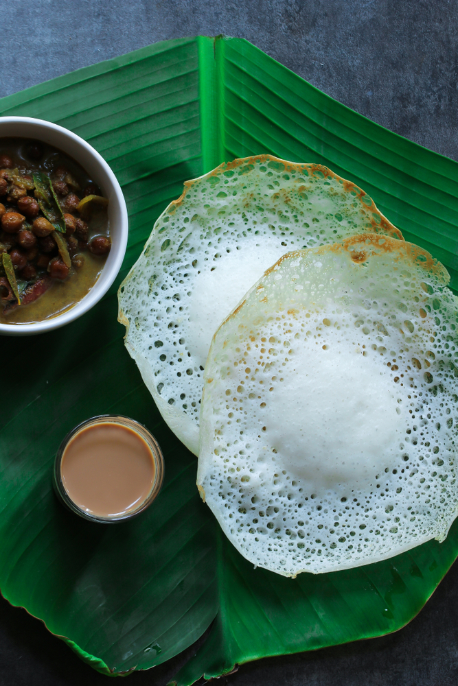 If you're unable to travel to beautiful Kerala, then don't despair! The Kerala breakfast ideas I'm going to show you will bring Kerala to your kitchen. This Appam recipe is a thin crepe-like pancake made from rice flour. It definitely is delicious!