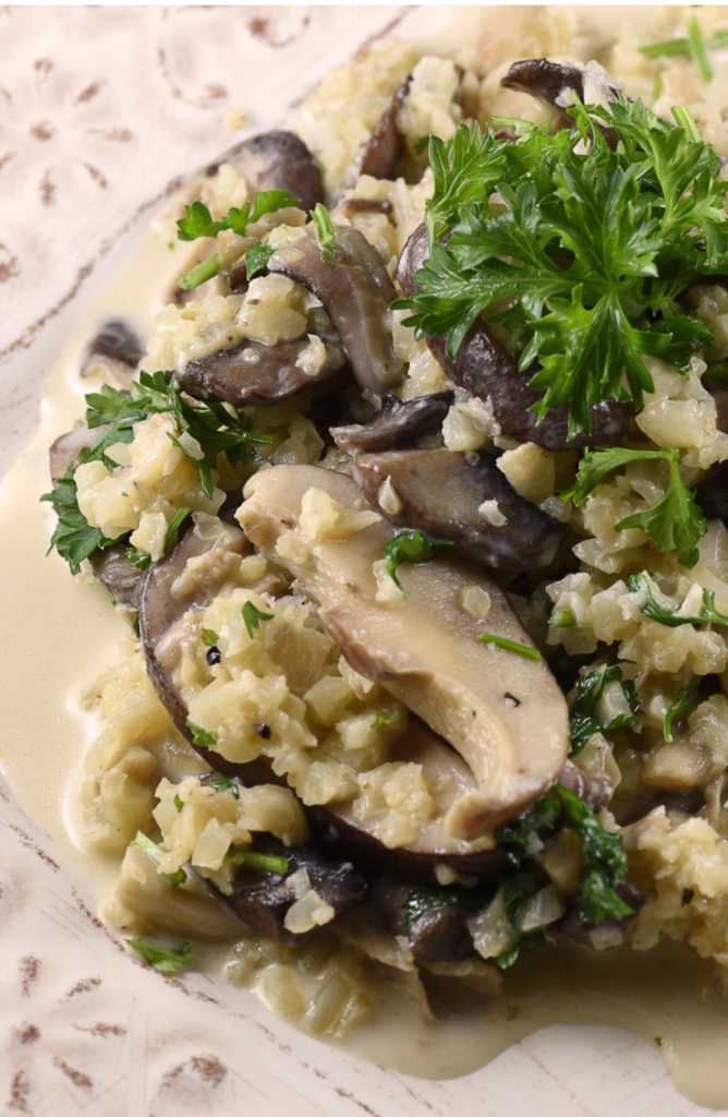 If you haven't used riced cauliflower when cooking, then you're missing out! Check out these delicious riced cauliflower recipes! This vegan riced cauliflower mushroom risotto is incredible!